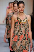 Models walk the runway in designs by Zimmermann on the catwalk at the Overseas Passenger Terminal Circular Quay on day two of Rosemount Australian...