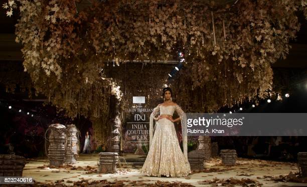 Models walk the runway in 'Tarakanna' the bridal couture collection 201718 by couturier Tarun Tahiliani during FDCI's India Couture Week 2017 at the...