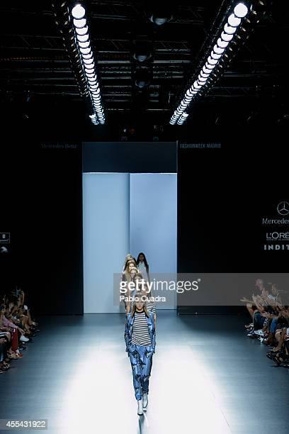 Models walk the runway in the Juan Vidal fashion show during Mercedes Benz Fashion Week Madrid Spring/Summer 2015 at Ifema on September 14 2014 in...