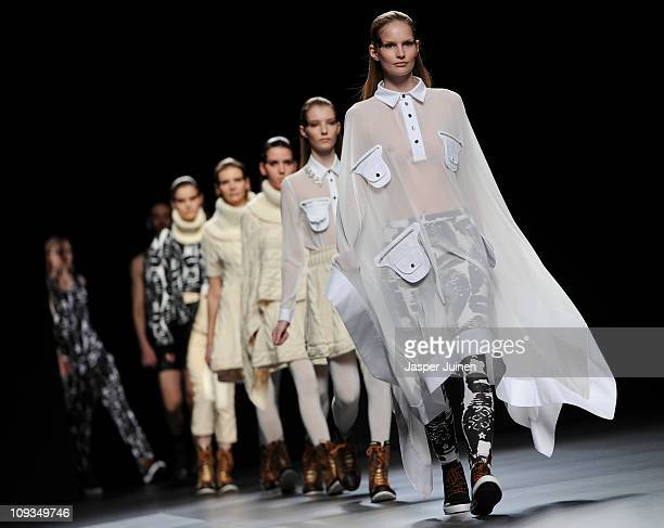 Models walk the runway in the Martin Lamothe Carlos Diez fashion show during the Cibeles Madrid Fashion Week Autumn/Winter 2011 at the Ifema on...