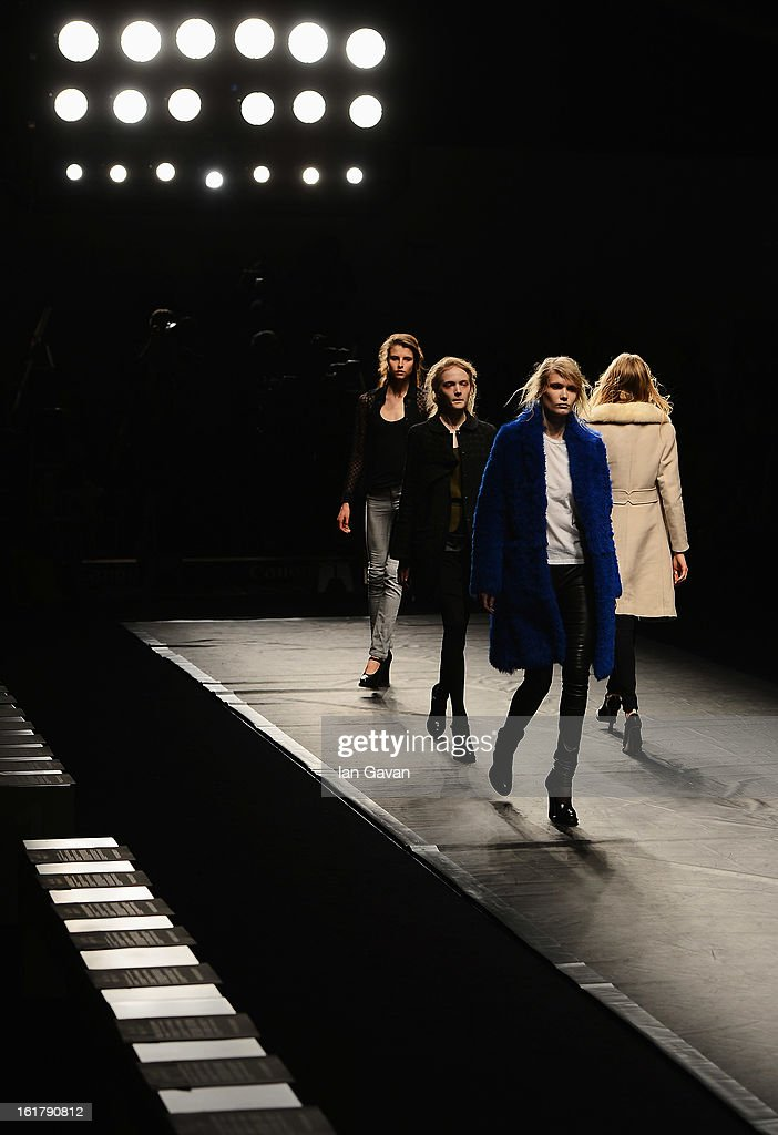 Models walk the runway prior to the John Rocha show during London Fashion Week Fall/Winter 2013/14 at Somerset House on February 16, 2013 in London, England.