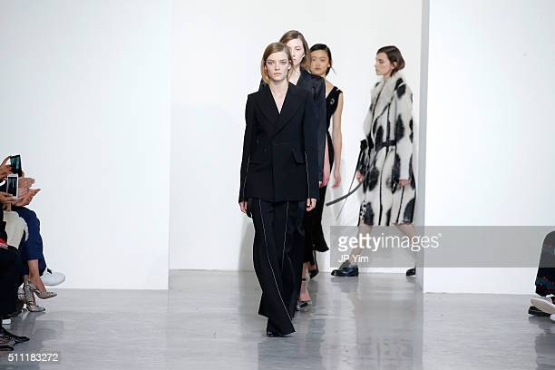 Models walk the runway wearing Calvin Klein Collection Fall 2016 for the shows finale during New York Fashion Week at Spring Studios on February 18...