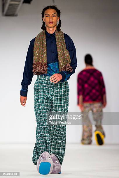 Models walk the runway wearing designs by Brogan TytheMcCalum during the University of Salford show during day 1 of Graduate Fashion Week 2014 at The...