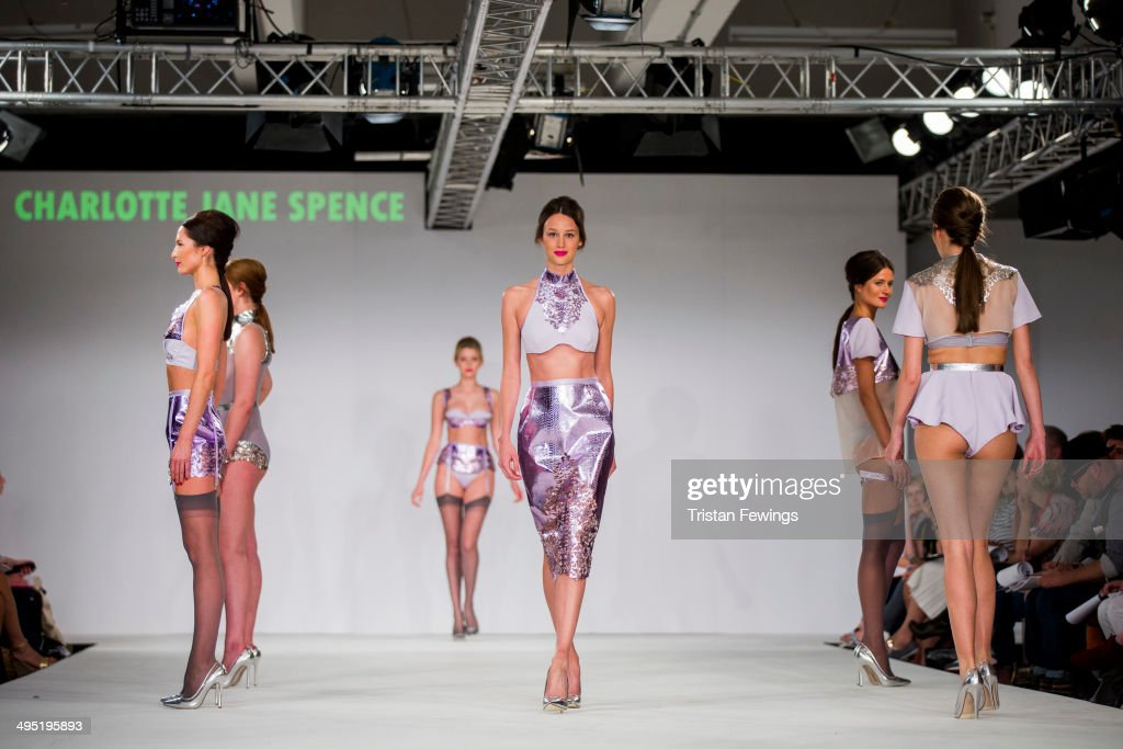 Models walk the runway wearing designs by Charlotte Jane Spence during the De Montfort Contour show during day 2 of Graduate Fashion Week 2014 at The Old Truman Brewery on June 1, 2014 in London, England.