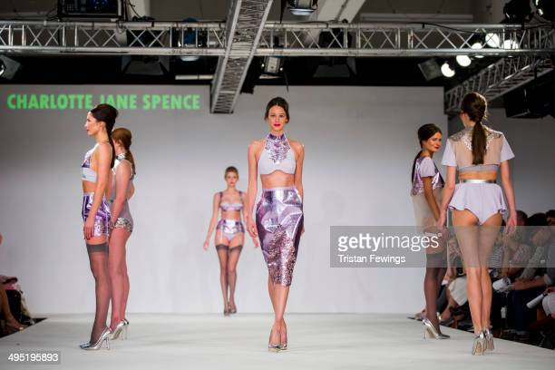 Models walk the runway wearing designs by Charlotte Jane Spence during the De Montfort Contour show during day 2 of Graduate Fashion Week 2014 at The...