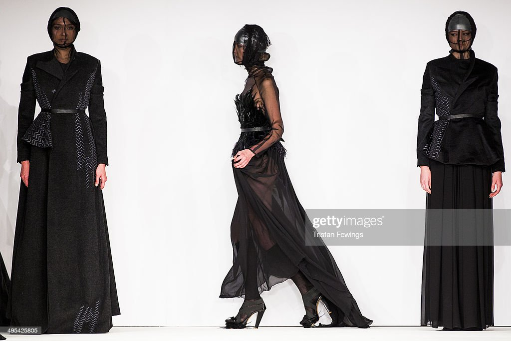 Models walk the runway wearing designs by Claudio Cutugno from IED during the International Catwalk Competition show during day 4 of Graduate Fashion Week 2014 at The Old Truman Brewery on June 3, 2014 in London, England.