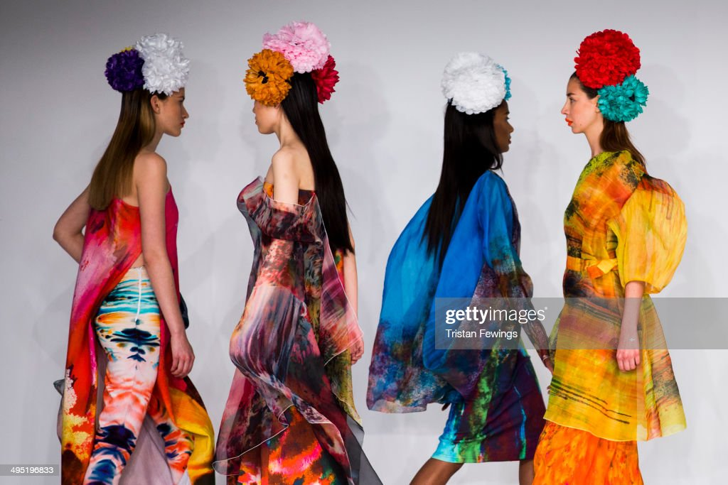 Models walk the runway wearing designs by Emma Rahman during the Wiltshire College Salisbury show during day 2 of Graduate Fashion Week 2014 at The Old Truman Brewery on June 1, 2014 in London, England.