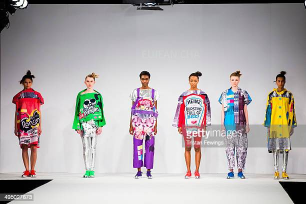 Models walk the runway wearing designs by Eujean Cha during the UCA Epsom show during day 2 of Graduate Fashion Week 2014 at The Old Truman Brewery...