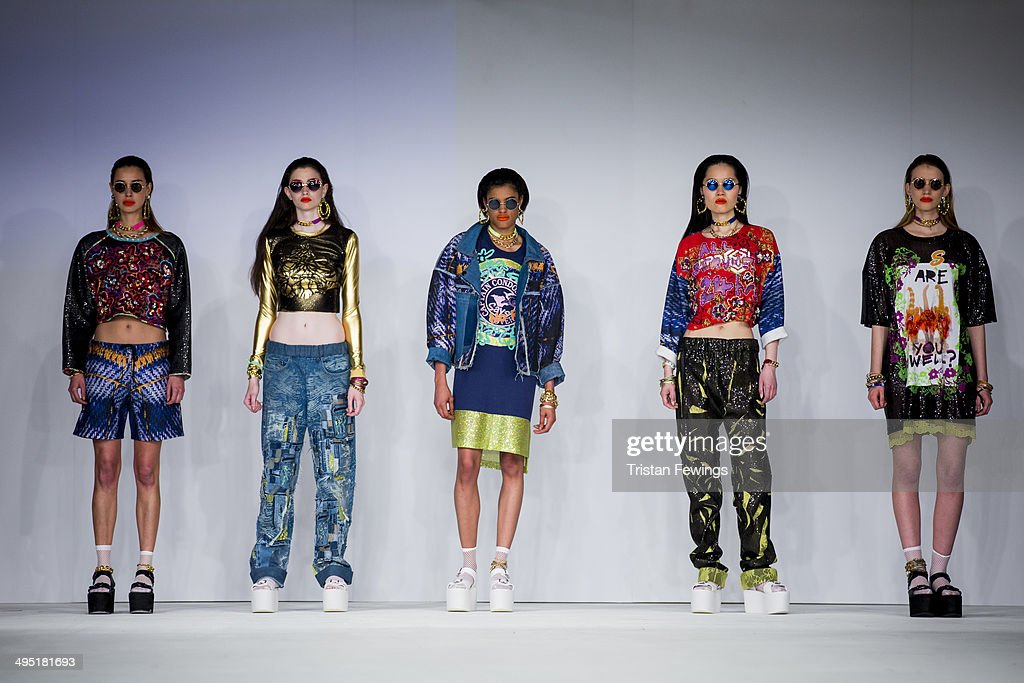 Models walk the runway wearing designs by Georigia Bruton during the Northbrook College show during day 2 of Graduate Fashion Week 2014 at The Old Truman Brewery on June 1, 2014 in London, England.
