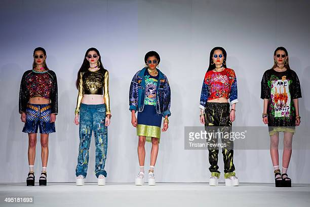 Models walk the runway wearing designs by Georigia Bruton during the Northbrook College show during day 2 of Graduate Fashion Week 2014 at The Old...