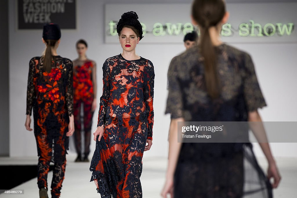 Models walk the runway wearing designs by Grace Miller during the Best of Graduate Fashion Week show during day 4 of Graduate Fashion Week 2014 at The Old Truman Brewery on June 3, 2014 in London, England.