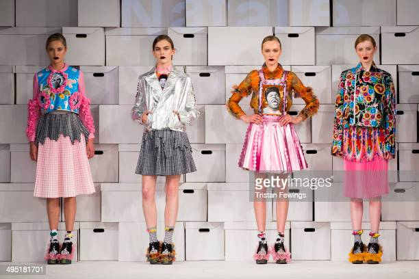 Models walk the runway wearing designs by Natalie Dawson during the Manchester School of Art show during day 2 of Graduate Fashion Week 2014 at The...