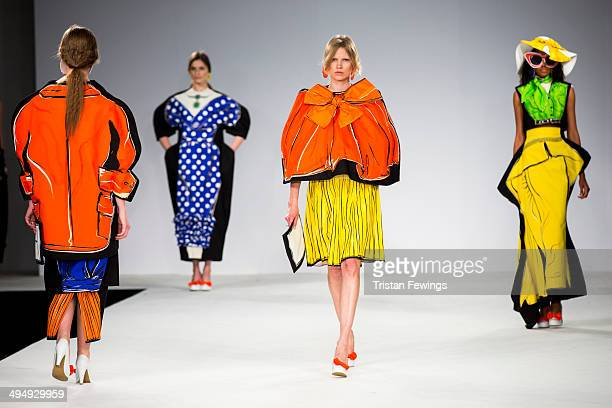 Models walk the runway wearing designs by Rebecca Rimmer during the University of Central Lancashire show during day 1 of Graduate Fashion Week 2014...