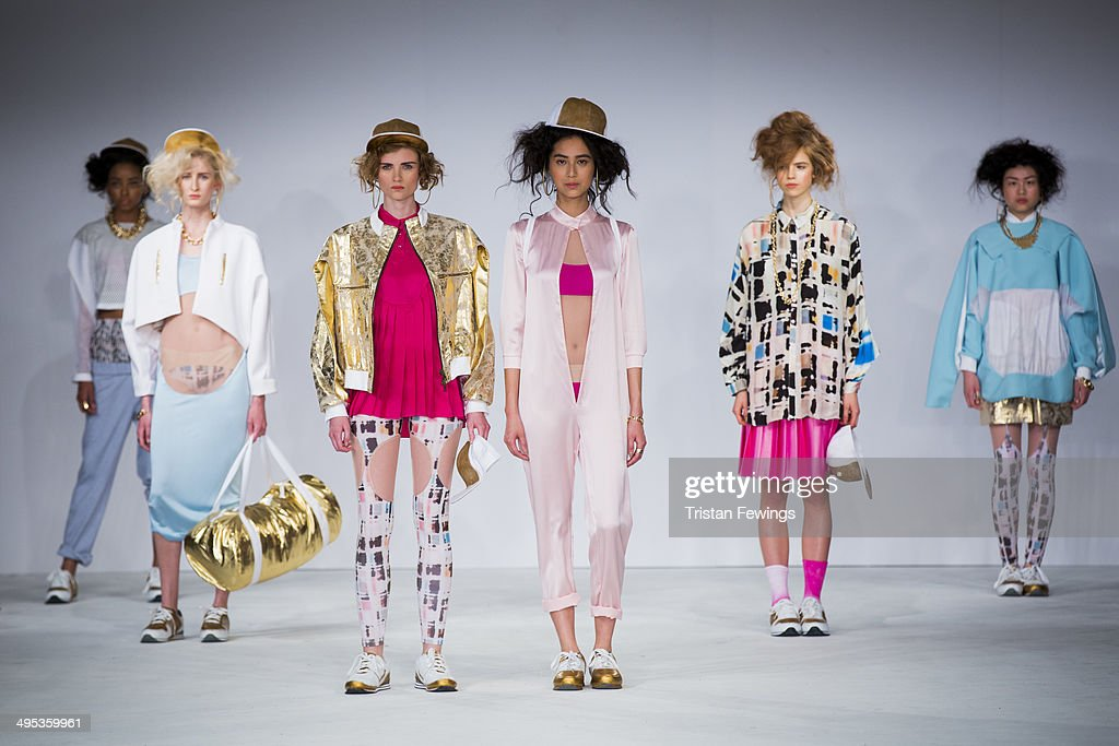Models walk the runway wearing designs by Robyn Tilbury during the Birmingham City University show during day 3 of Graduate Fashion Week 2014 at The Old Truman Brewery on June 2, 2014 in London, England.