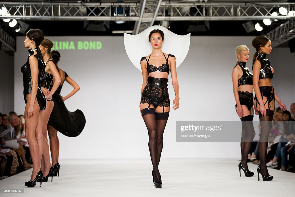 Models walk the runway wearing designs by Selina Bond during the De Montfort Contour show during day 2 of Graduate Fashion Week 2014 at The Old Truman Brewery on June 1, 2014 in London, England.