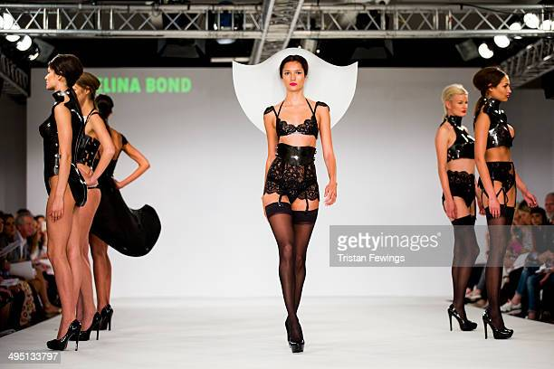 Models walk the runway wearing designs by Selina Bond during the De Montfort Contour show during day 2 of Graduate Fashion Week 2014 at The Old...