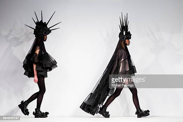 Models walk the runway wearing designs by Tianyi Li during the University of East London show during day 1 of Graduate Fashion Week 2014 at The Old...