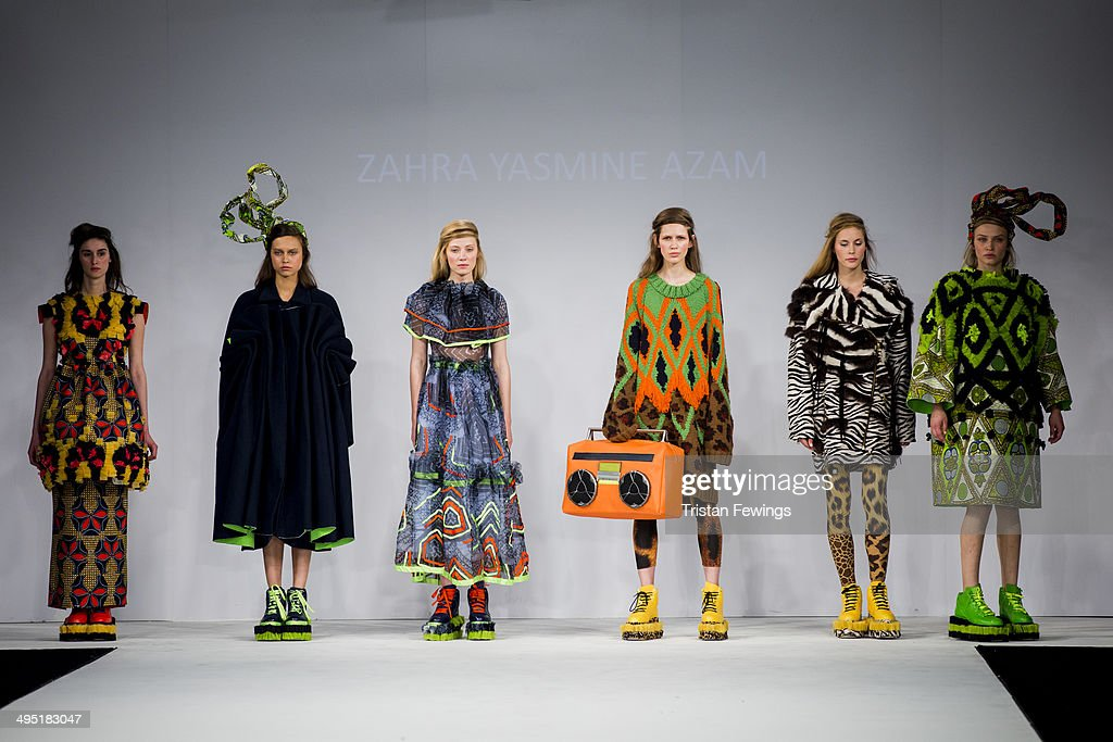 Models walk the runway wearing designs by Zahra Yasmine Azam during the UCA Epsom show during day 2 of Graduate Fashion Week 2014 at The Old Truman Brewery on June 1, 2014 in London, England.