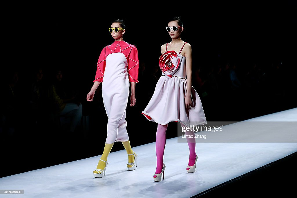 Models walk the runway wearing designs the by Beijing Union University show during the 2014 China Graduate Fashion Week at the 751D-PARK Work shop on April 27, 2014 in Beijing, China.