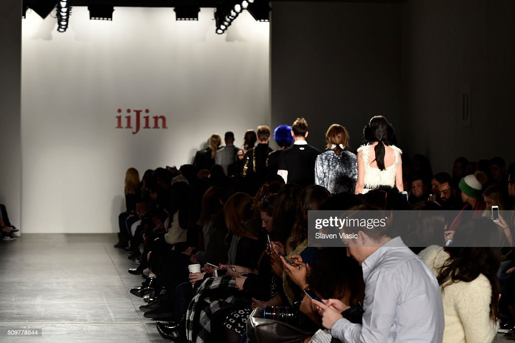 Models walk the runway wearing iiJin Fall 2016 during New York Fashion Week at Pier 59 on February 12, 2016 in New York City.