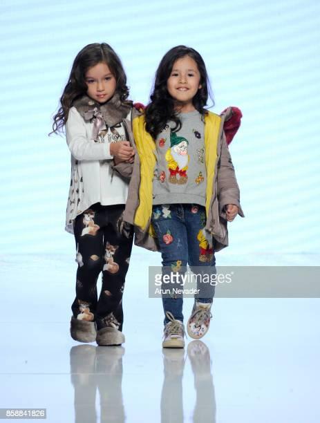 Models walk the runway wearing Monnalisa at Los Angeles Fashion Week SS18 Art Hearts Fashion LAFW on October 7 2017 in Los Angeles California