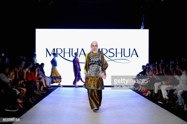 Models walk the runway wearing MRHUA MRSHUA at 2017 Vancouver Fashion Week Day 7 on September 24 2017 in Vancouver Canada