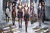 Models walk the runway wearing Rodarte Fall 2015 during MercedesBenz Fashion Week at Center 548 on February 17 2015 in New York City