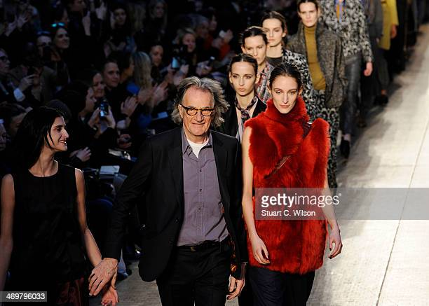 Models walk the runway with Paul Smith after his show at London Fashion Week AW14 on February 16 2014 in London England