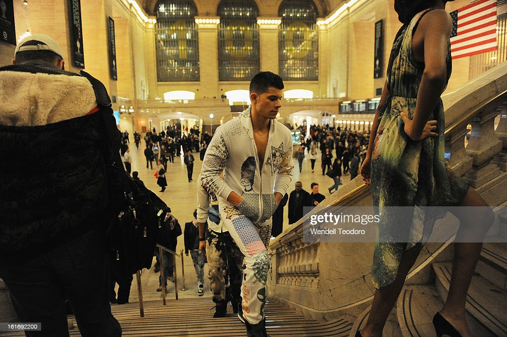 Models walk through Grand Central Station as part of the Indashio Show during Fall 2013 Mercedes-Benz Fashion Week on February 13, 2013 in New York City.