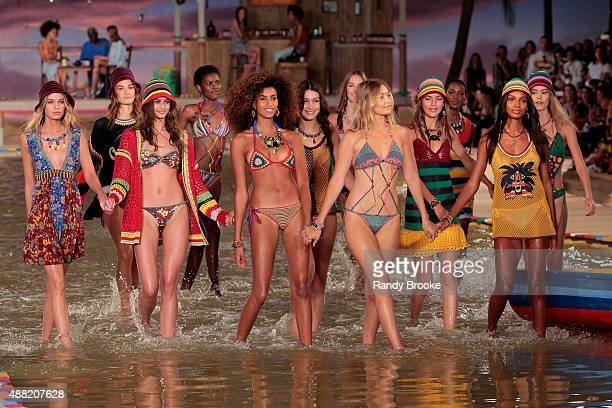 Models walk through water at Tommy Hilfiger Women's Spring 2016 during New York Fashion Week The Shows at Pier 36 on September 14 2015 in New York...