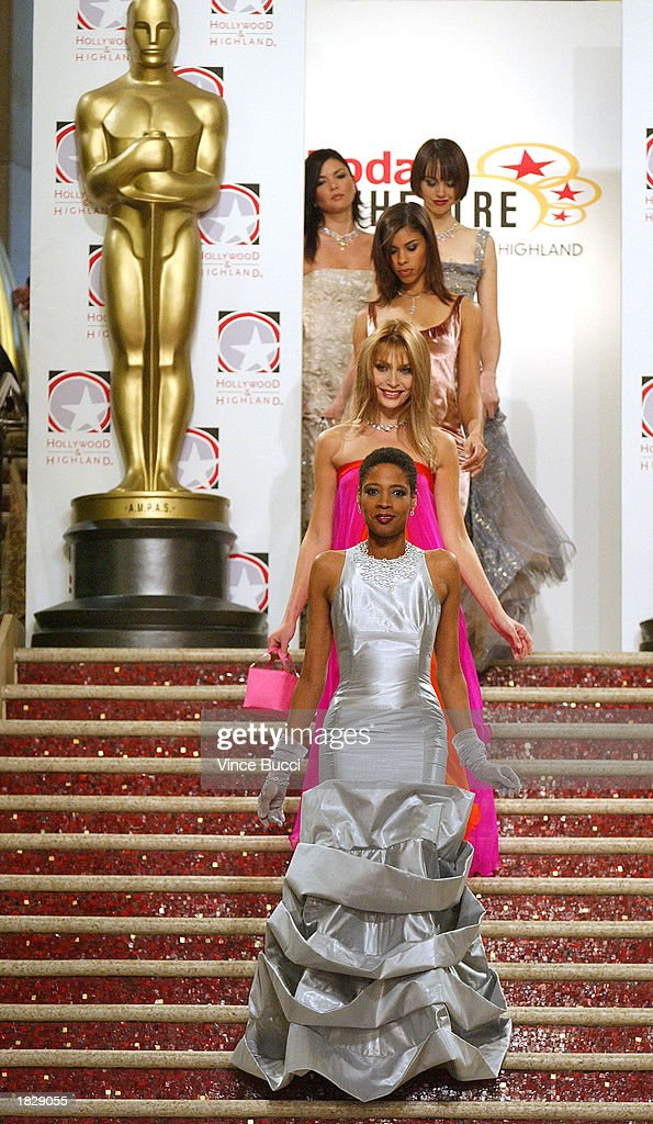 Models walk to the runway at the 2003 Oscar Fashion Preview at the Kodak Theatre on March 4, 2003 in Hollywood, California.