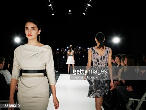 Models walking on runway during fashion show