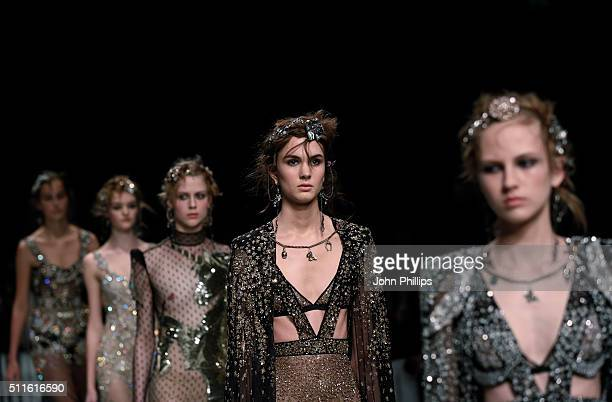 Models walks the runway at the Alexander McQueen show during London Fashion Week Autumn/Winter 2016/17 at Royal Horticultural Society on February 21...