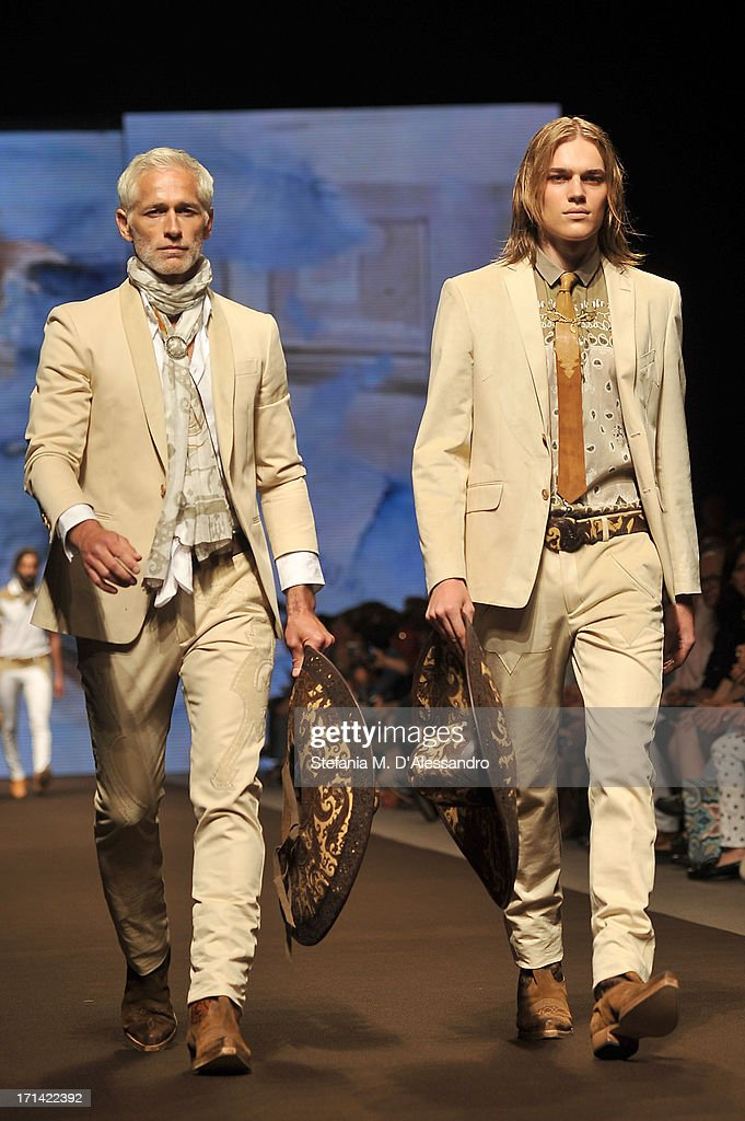 Models walks the runway at the Etro show during Milan Menswear Fashion Week Spring Summer 2014 show on June 24, 2013 in Milan, Italy.
