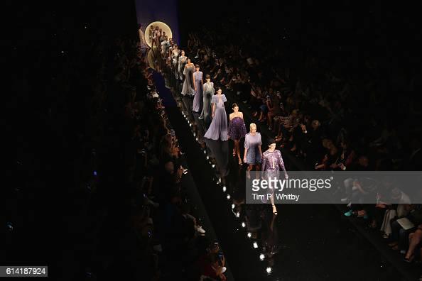 Models walks the runway at the Ozgur Masur show during MercedesBenz Fashion Week Istanbul at Zorlu Center on October 12 2016 in Istanbul Turkey