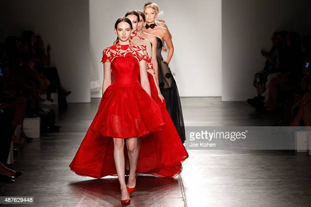 Models walks the runway during Australian Evening Bridal Wear Spring 2016 New York Fashion Week The Shows at Pier 59 on September 10 2015 in New York...