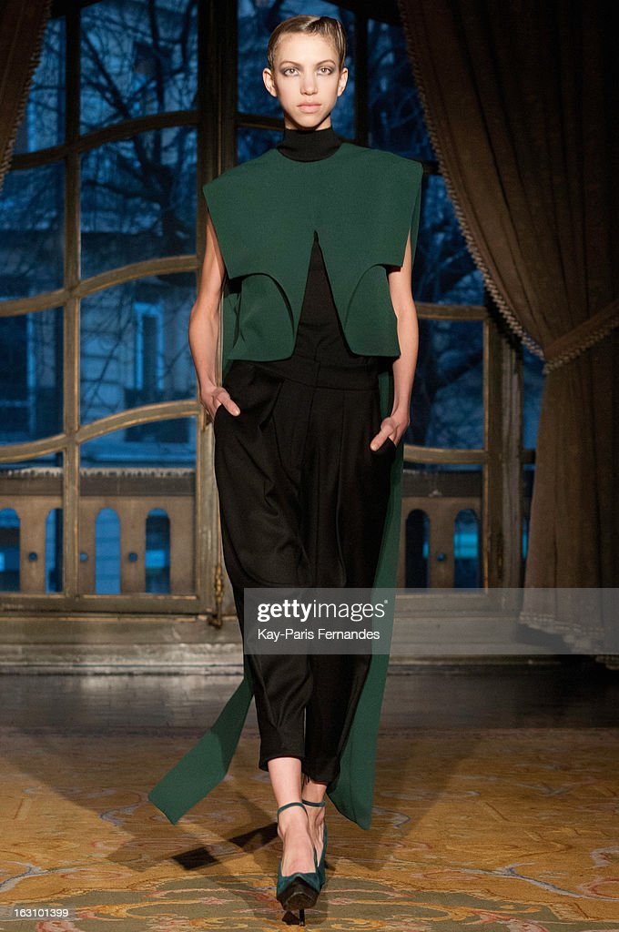A models walks the runway during the Amaya Arzuaga Fall/Winter 2013 Ready-to-Wear show as part of Paris Fashion Week at the Ambassade D'Espagne on March 4, 2013 in Paris, France.