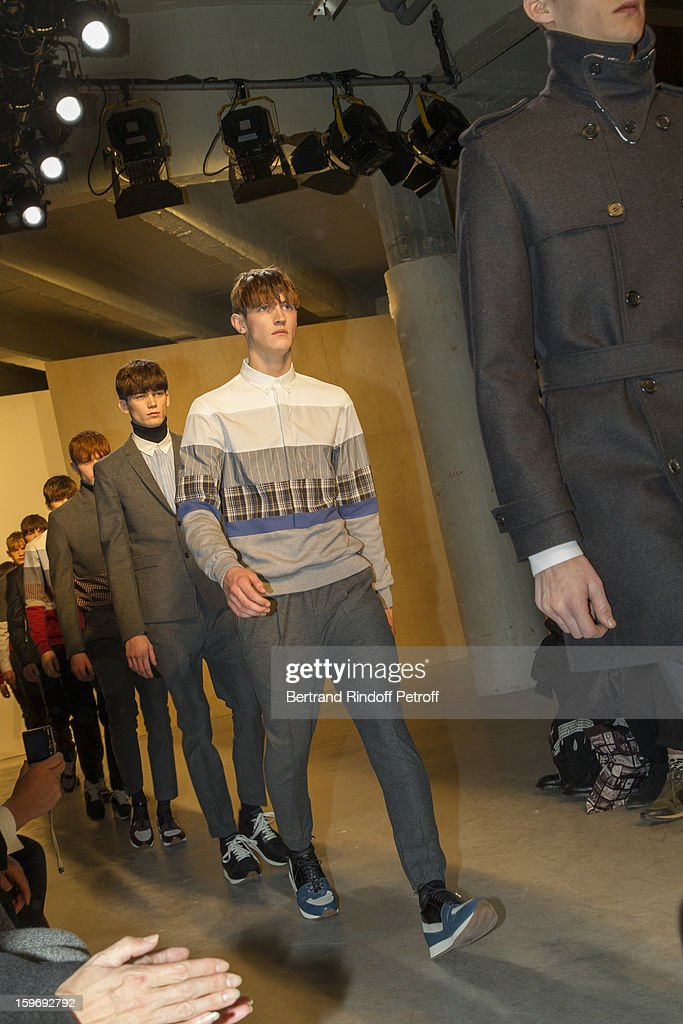 Models walks the runway during the Krisvanassche Men Autumn / Winter 2013 show as part of Paris Fashion Week on January 18, 2013 in Paris, France.