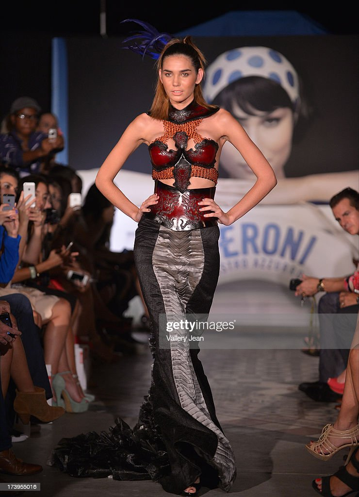 A models walks the runway during the Peroni Emerging Designer Series presented by Fashion Group on July 17, 2013 in Miami, Florida.