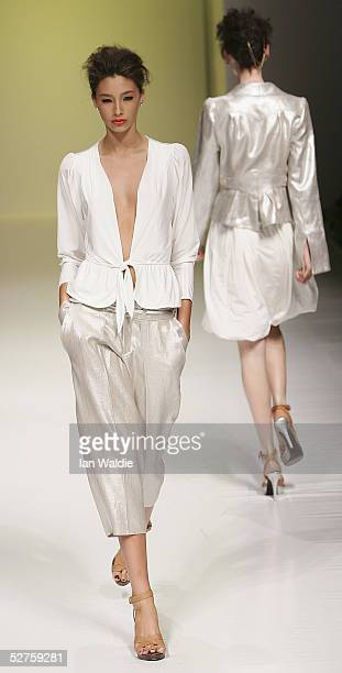 Models walks the runway for the Bettina Liano Collection in the Cargo Room at the Overseas Passenger Teminal during the Mercedes Australian Fashion...