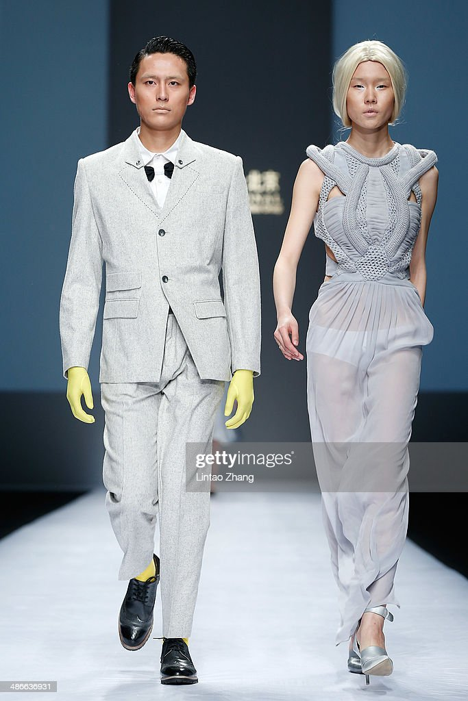 Models walks the runway wearing designs the by ESMOD Beijing Graduates Show during the 2014 China Graduate Fashion Week at the 751D-PARK Work shop on April 25, 2014 in Beijing, China.