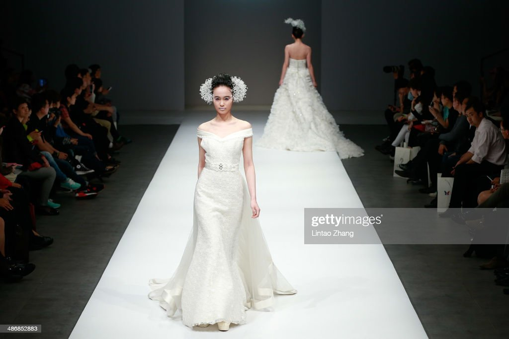Models walks the runway wearing designs the by Jiangxi Institute of Fashion Technology Graduates Show during the 2014 China Graduate Fashion Week at the 751D-PARK Work shop on April 26, 2014 in Beijing, China.