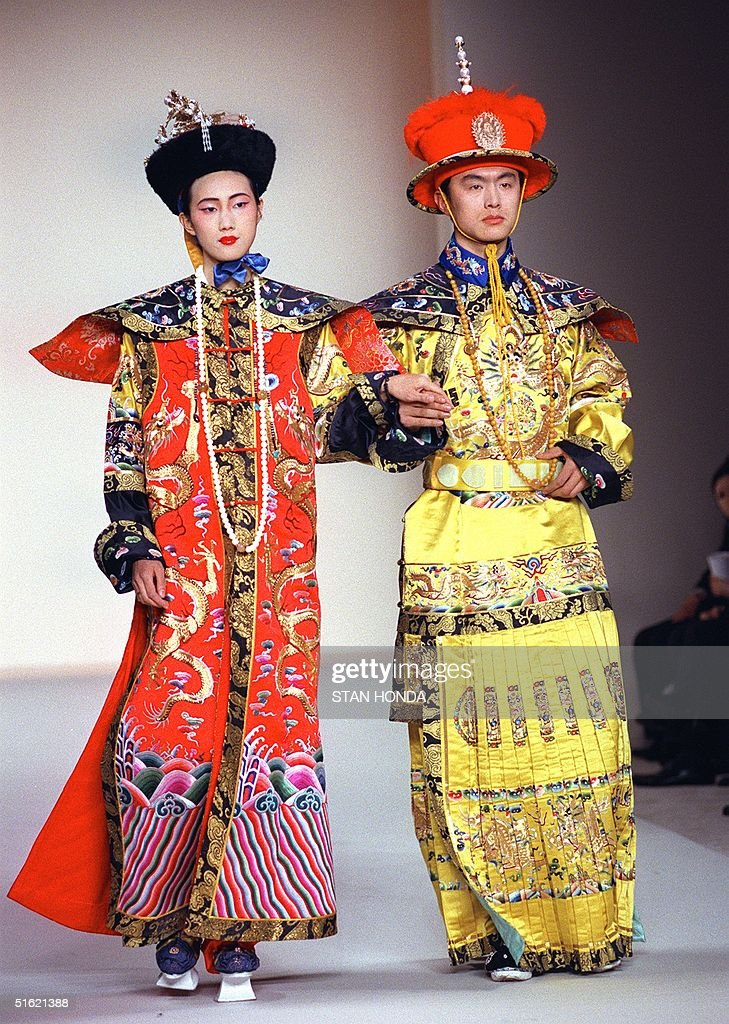 Models wear a recreation of court robes for an Emperor and an Empress in the Qing Dynasty of China during the China Millenium fashion show 19...