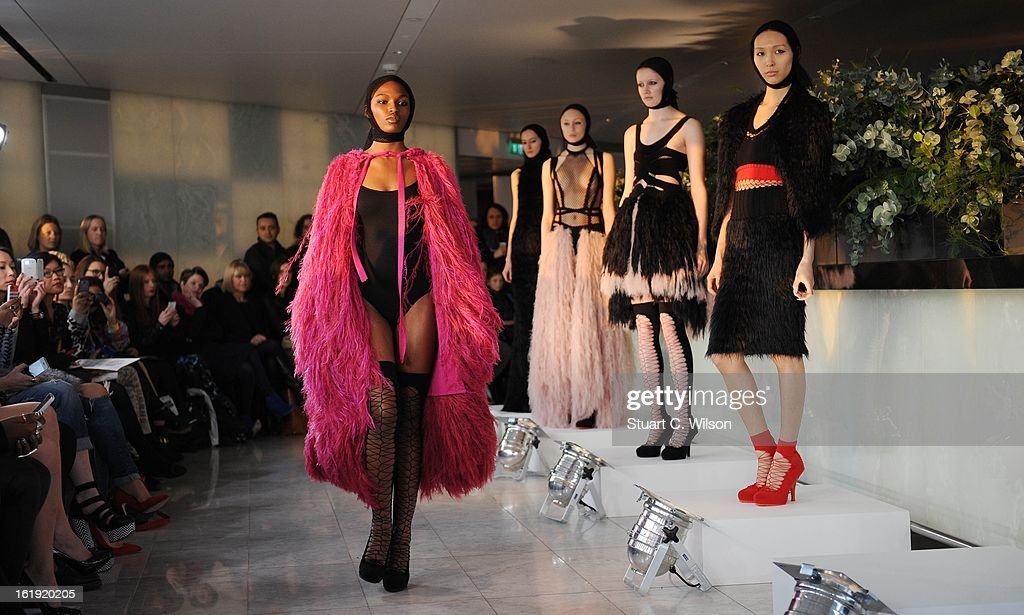 Models wear designs at the Mark Fast salon show during London Fashion Week Fall/Winter 2013/14 at ME Hotel on February 17, 2013 in London, England.