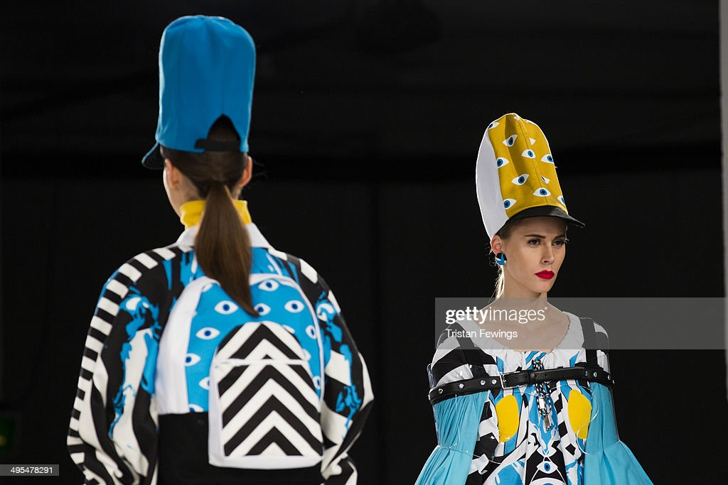 Models wear designs by Holly Jane Smith on the runway during the GFW Awards Show during day 4 of Graduate Fashion Week 2014 at The Old Truman Brewery on June 3, 2014 in London, England.