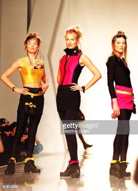 Models wear short skirts over leggings and sleeveless tops during the Donna Karan New York Fall 94 collection show at the Bryant Park Pavilion 06...