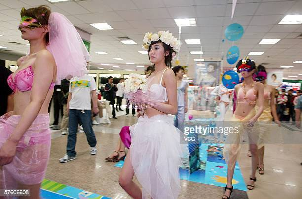 Models wear underwear during a Mother's Day promotion in a deparment store on May 13 2006 in Shenyang City Liaoning Province China
