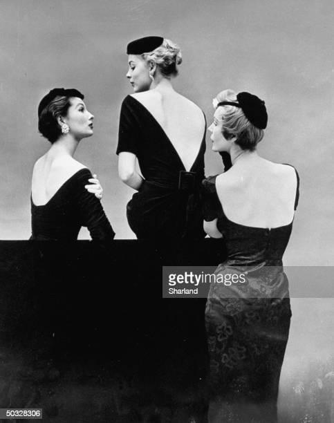 Models wearing barebacked black cocktail dresses
