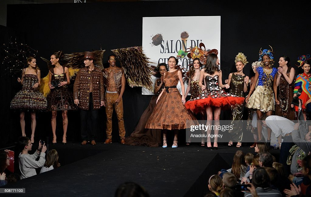 Models wearing costumes made of chocolate walk the runway during the Brussels Chocolate Fair, also known as Salon Du Chocolat, in Brussels, Belgium, on February 6, 2016. The Salon du Chocolat is a yearly trade fair for the international chocolate industry.
