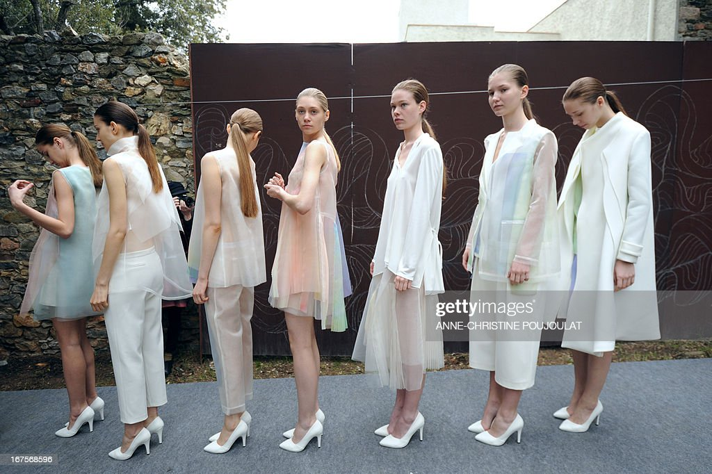 Models wearing creations by Chinese fashion designer Shanshan Ruan wait before presenting to the jury on April 26, 2013, during the 28th edition of the International Festival of Fashion and Photography in the French southern city of Hyeres. This year's President of the Jury is Portuguese fashion designer Felipe Oliveira Baptista. AFP PHOTO /ANNE-CHRISTINE POUJOULAT